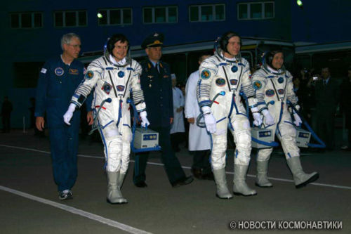 Cosmonauts wearing Sokol spacesuits and headsets.